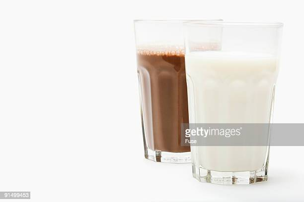 Glasses of milk and chocolate milk