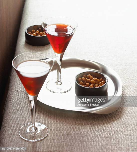 Glasses of negroni and snacks