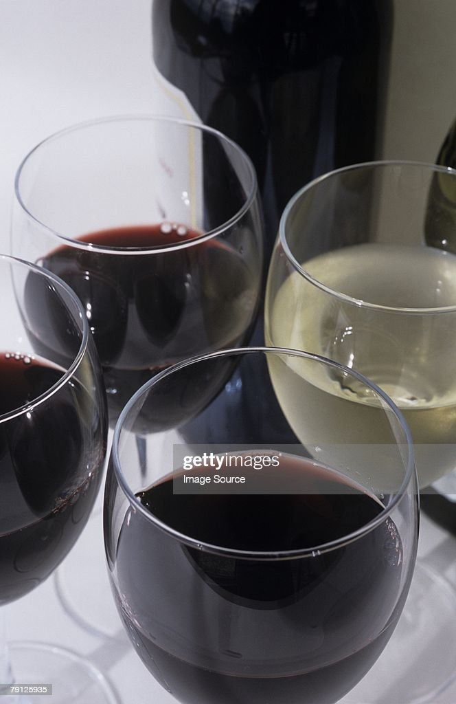 Glasses of red and white wine : Stock Photo