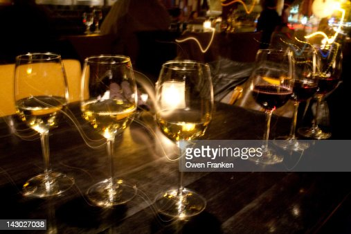 Glasses of red and white wines : Stock Photo