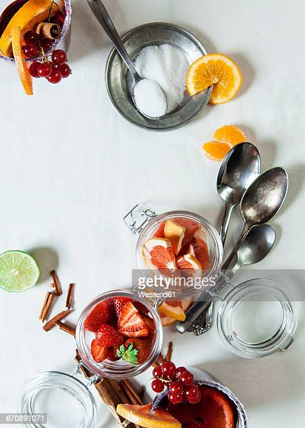 Glasses of Sangria and glasses of different fruits