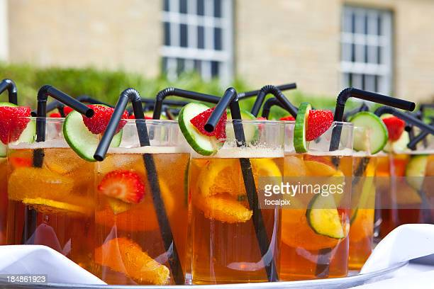 Glasses of Summer Cup on white tablecloth at garden party