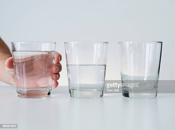 Glasses of water in a row