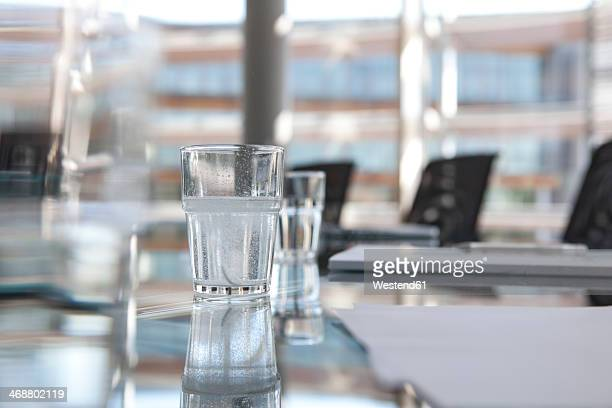 Glasses of water on conference room table