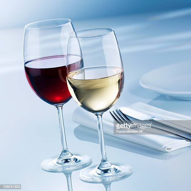 Glasses of white wine and red wine, close-up