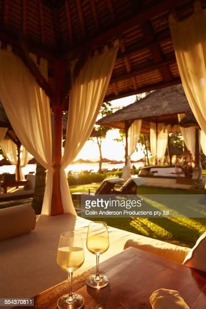 Glasses of white wine in cabana