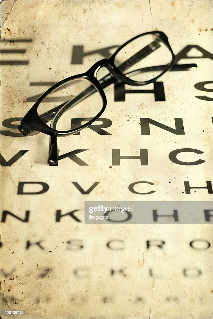 Glasses on a chart : Stock Photo