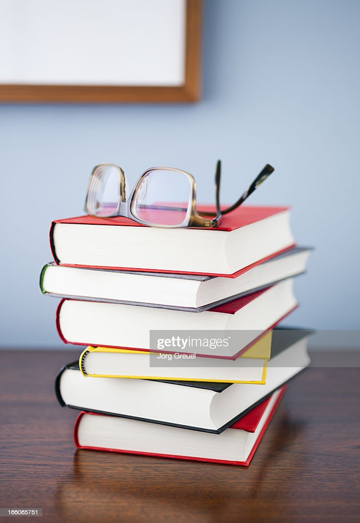 Glasses on a stack of books