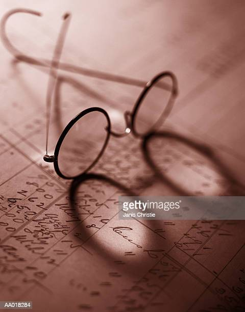 Glasses on an Accounting Ledger