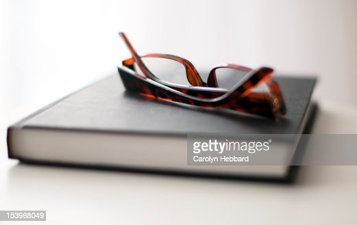 Glasses on book : Stock Photo