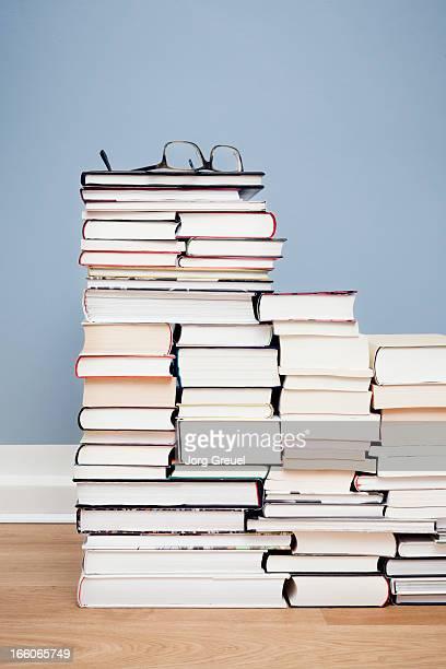 Glasses on stacks of books