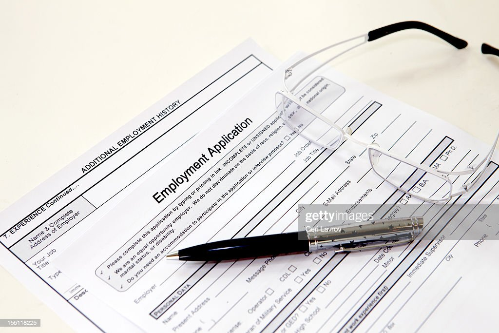 Glasses, pen, and job application form : Stock Photo