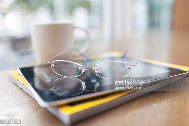 glasses, tablet PC, magazine in coffee shop