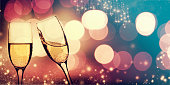 Glasses with champagne against fireworks - NEw Year's concept