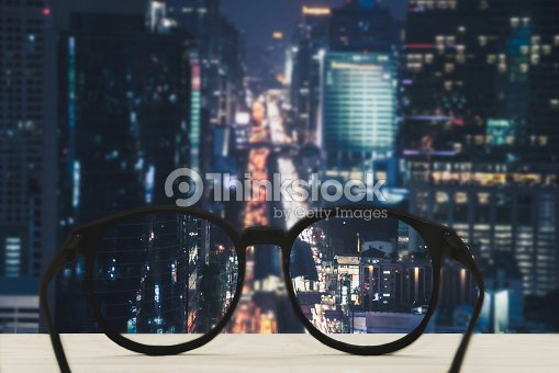 1e4791ba4b Glasses With Clear Vision Of Night Cityscape Focused Stock Photo ...