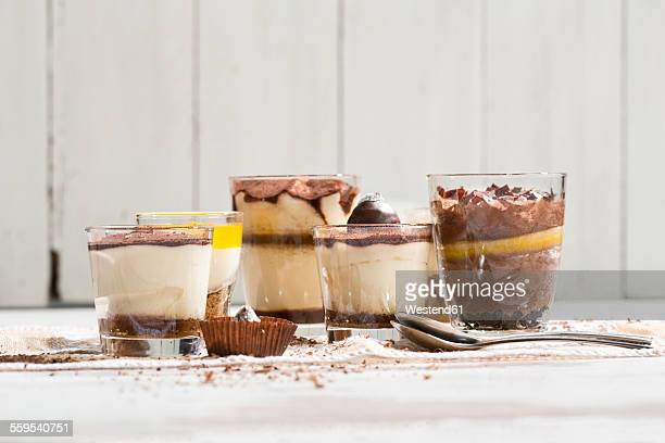 Glasses with different sorts of desserts