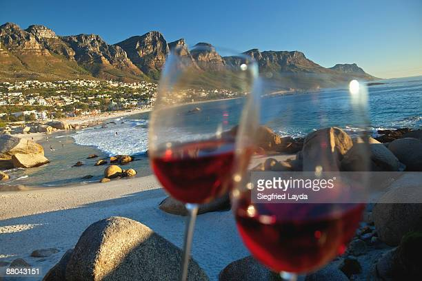 2 glasses with red wine at sunset