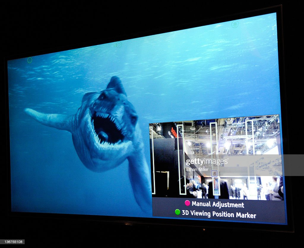 A glasses-free Toshiba 55-inch 3-D 4x full HD TV shows the movie, 'Sea Rex 3D: Journey to a Prehistoric World' at the 2012 International Consumer Electronics Show at the Las Vegas Convention Center January 11, 2012 in Las Vegas, Nevada. The TVs are scheduled to be available this year and will come with embedded cameras with facial recognition capability (demonstrated on the screen adjusting at right) so depending on where you are sitting, the set will adjust the viewing point for the best 3-D experience. CES, the world's largest annual consumer technology trade show, runs through January 13 and features more than 3,100 exhibitors showing off their latest products and services to about 140,000 attendees.