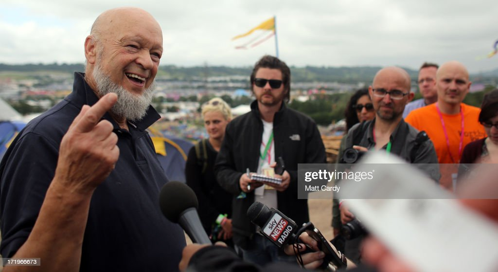 Glastonbury Festival founder Michael Eavis (L) speaks to the media at a press conference at the Glastonbury Festival of Contemporary Performing Arts site at Worthy Farm, Pilton on June 30, 2013 near Glastonbury, England. Gates opened on Wednesday at the Somerset diary farm that will be playing host to one of the largest music festivals in the world and this year features headline acts Artic Monkeys, Mumford and Sons and the Rolling Stones. Tickets to the event which is now in its 43rd year sold out in minutes and that was before any of the headline acts had been confirmed. The festival, which started in 1970 when several hundred hippies paid 1 GBP to watch Marc Bolan, now attracts more than 175,000 people over five days.