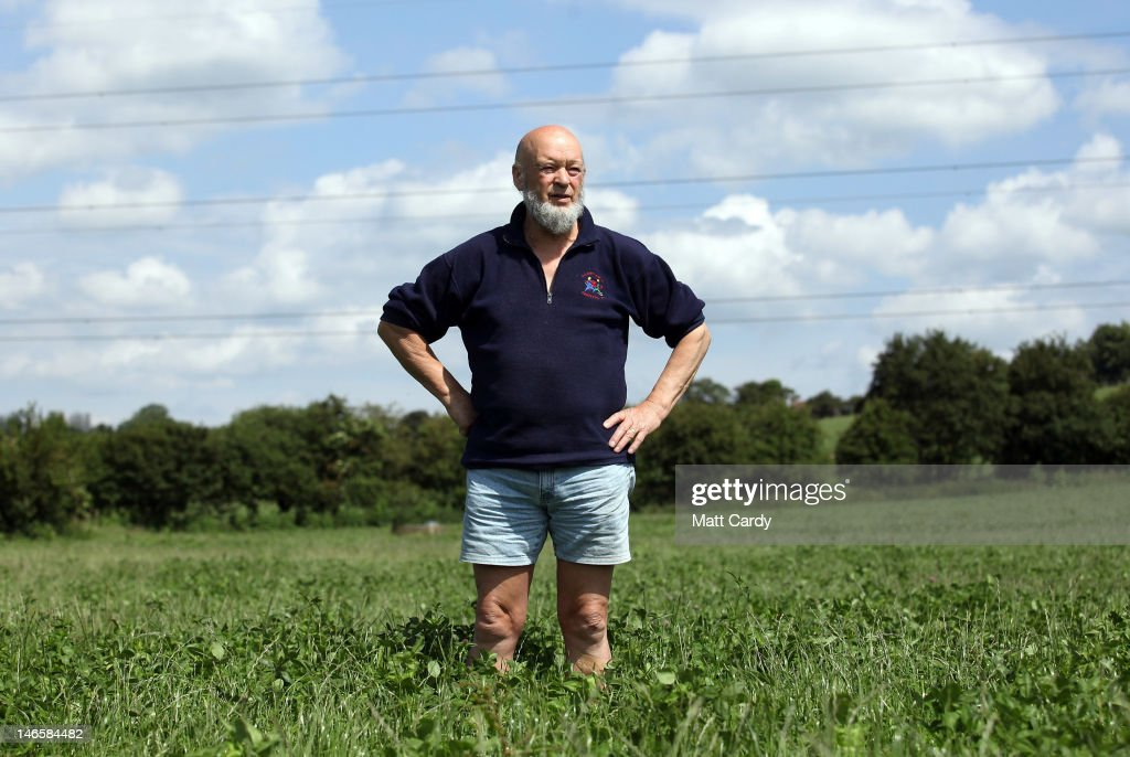 Glastonbury Festival founder Michael Eavis stands in a field of uncut grass in front of the skeleton of the main Pyramid Stage at the Glastonbury Festival site at Worthy Farm, Pilton on June 20, 2012 near Glastonbury, England. Today would have been the day that the gates would have opened for what has become Europe's biggest music festival, but because of the London 2012 Olympics it was decided by the organisers to take this year off. However, this week it was announced that the festival - which started in 1970 when several hundred festival-goers paid 1 GBP to watch Marc Bolan and has now attracts more than 175,000 people over five days - will feature in a mosh-pit style tribute in the opening ceremony of the London 2012 Olympic Games. The Festival will return in June 2013.