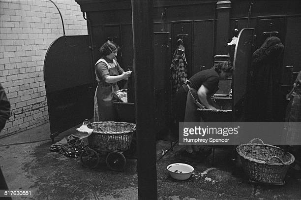 Glaswegian housewives doing their laundry at a municipal washhouse known as a 'steamie' which is connected to the public baths Glasgow March 1939...