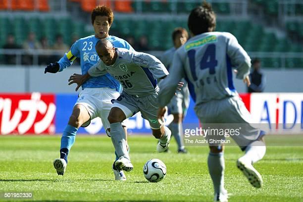 Glaucio of Avispa Fukuoka and Takashi Fukunishi of Jubilo Iwata compete for the ball during the JLeague match between Jubilo Iwata and Avispa Fukuoka...