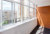 Glazed balcony with brick wall