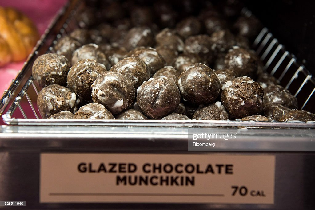 Glazed chocolate munchkins are displayed at a Dunkin' Donuts Inc. location in Ramsey, New Jersey, U.S., on Thursday, May 5, 2016. Dunkin' Brands Group Inc., a leading franchiser in the quick service restaurants (QSR) sector, operates in almost 60 countries around the world with more than 11,300 Dunkin' Donuts restaurants and 7,500 Baskin-Robbins locations. Photographer: Ron Antonelli/Bloomberg via Getty Images