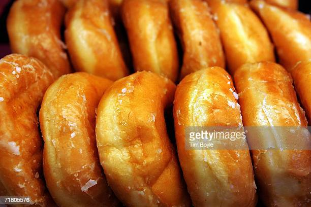 Glazed donuts are displayed at a Dunkin' Donuts store September 7 2006 in Chicago Illinois In an effort to compete with Starbucks in the lucrative...