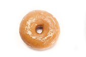 A single glazed doughnut isolated on white viewed from above
