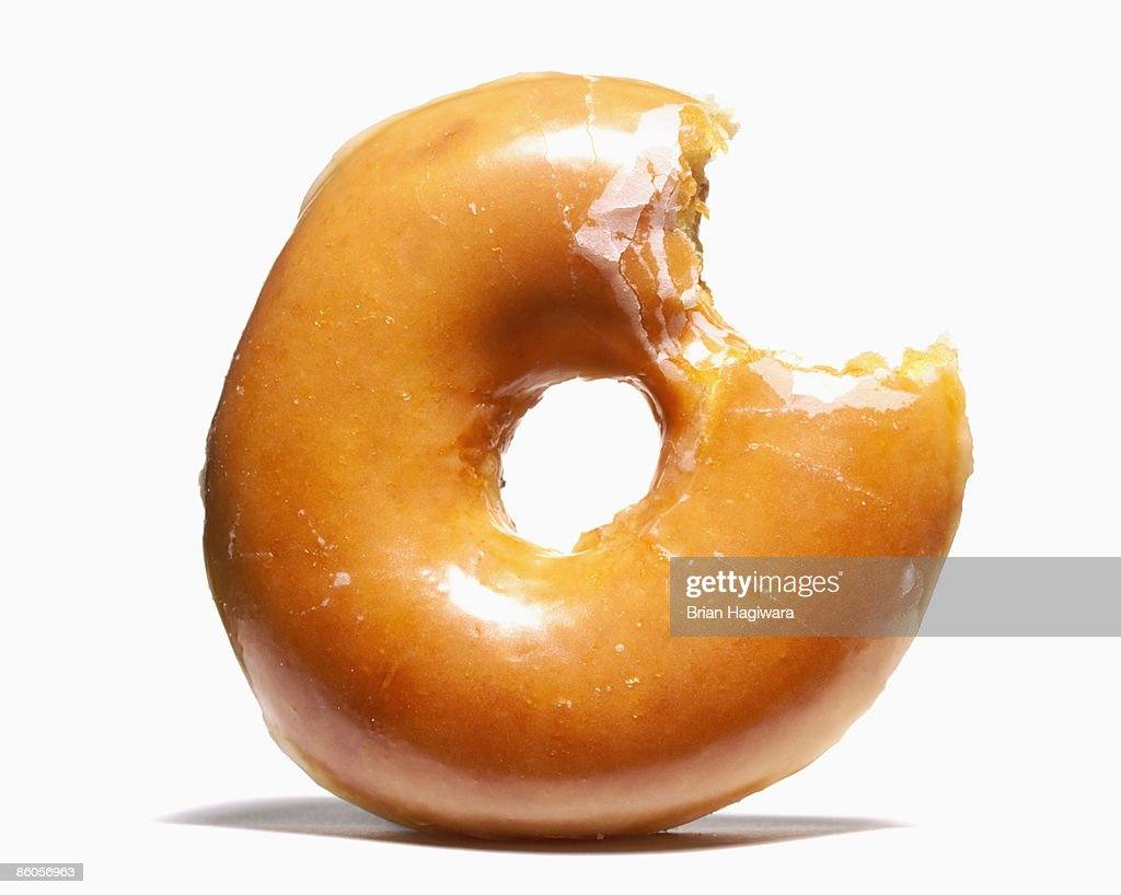 Glazed doughnut with missing bite