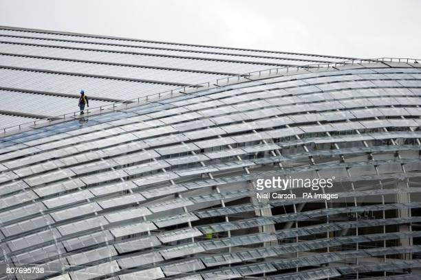 A glazier at work on the new Aviva Stadium in Dublin which will see its first match on July 31 2010