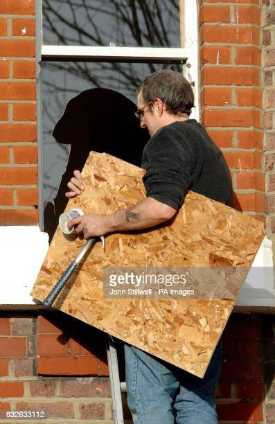 A glazier prepares to repair a broken window in north west London after a tornado ripped through the suburb of Kensal Rise
