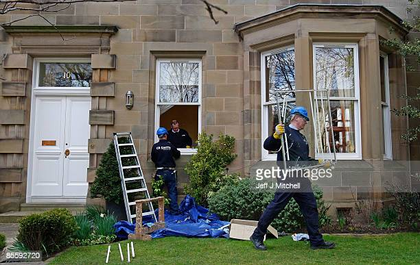 A glazier removeS a smashed window at the Edinburgh home of former Royal Bank of Scotland boss Sir Fred Goodwin after it was attack by vandals...