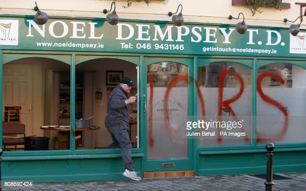 A glazier works on the damage to Fianna Fail Transport Minister Noel Dempsey TDs constituency office in Trim Meath The word 'Traitors' was sprayed on...