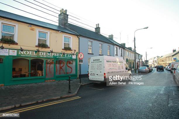 A glazier works on the damage to Fianna Fail Transport Minister Noel Dempsey TD's constituency office in Trim Meath The word 'Traitors' was sprayed...