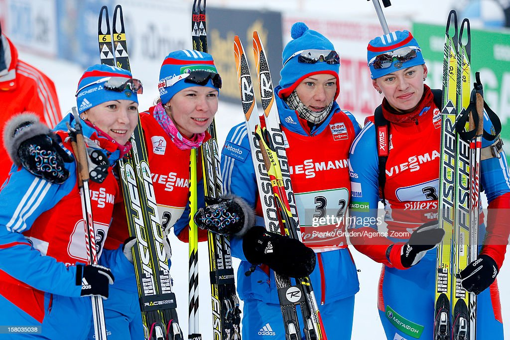 Glazyrina Ekaterina, Olga Zaitseva, Shumilova Ekaterina, Olga Vilukhina of Russia take 3rd place during the IBU Biathlon World Cup Women's Relay on December 09, 2012 in Hochfilzen, Austria.