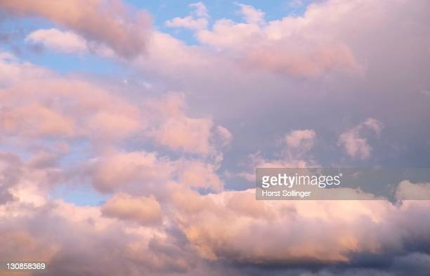 gleaming clouds floating on evening sky