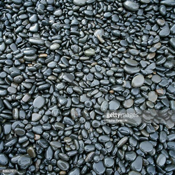 wet gravel wet pebbles stock photos and pictures getty images