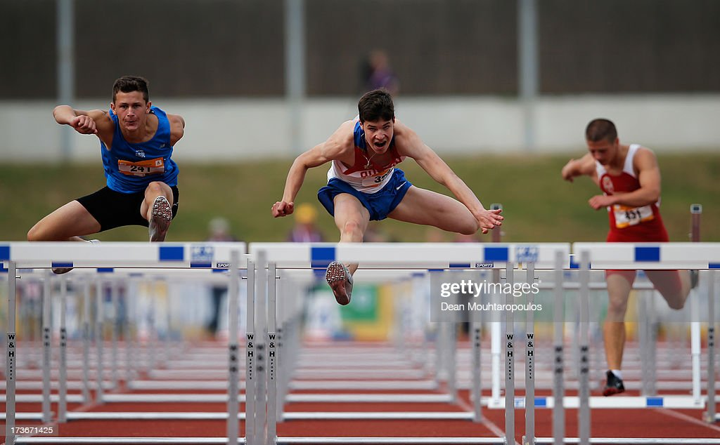 Gleb Egorov (#398) of Russia and Itamar Fayler (#241) of Israel compete in the Boys 110m hurdles during the European Youth Olympic Festival held at the Athletics Track Maarschalkersweerd on July 16, 2013 in Utrecht, Netherlands.