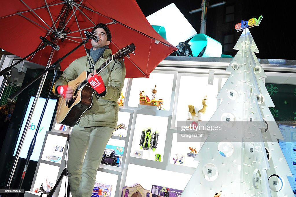 Glee's <a gi-track='captionPersonalityLinkClicked' href=/galleries/search?phrase=Darren+Criss&family=editorial&specificpeople=7341435 ng-click='$event.stopPropagation()'>Darren Criss</a> performs a holiday concert at The eBay Toy Box, which gives people a new way to give to Toys For Tots on December 9, 2012 in New York City.