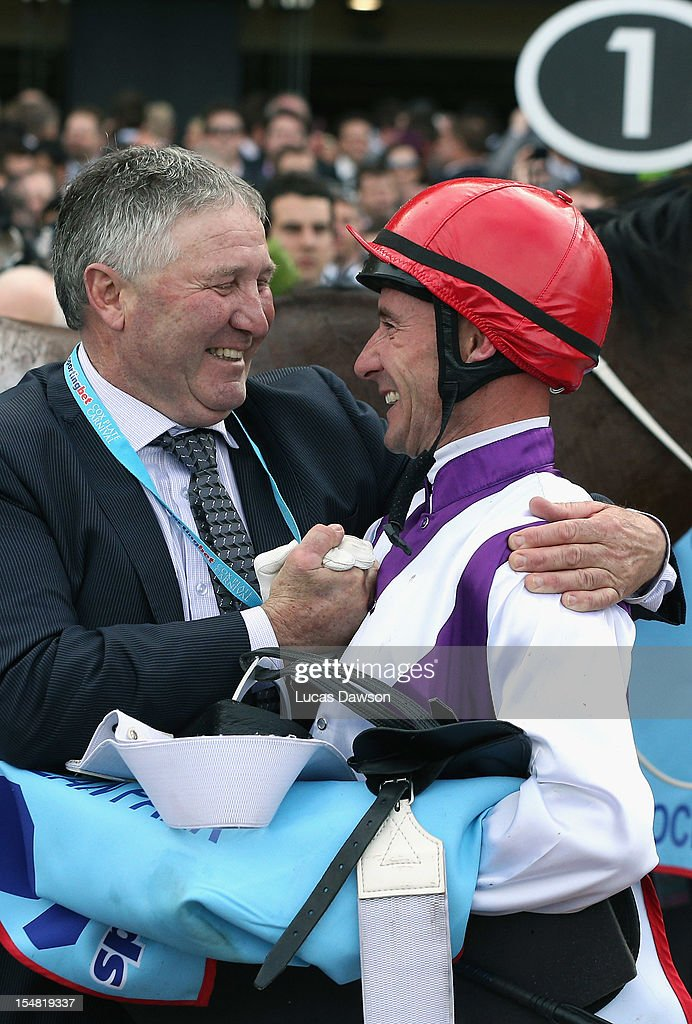 Glen Boss and Trainer celebrate winning the Cox Plate race during Cox Plate Day at Moonee Valley Racecourse on October 27, 2012 in Melbourne, Australia.