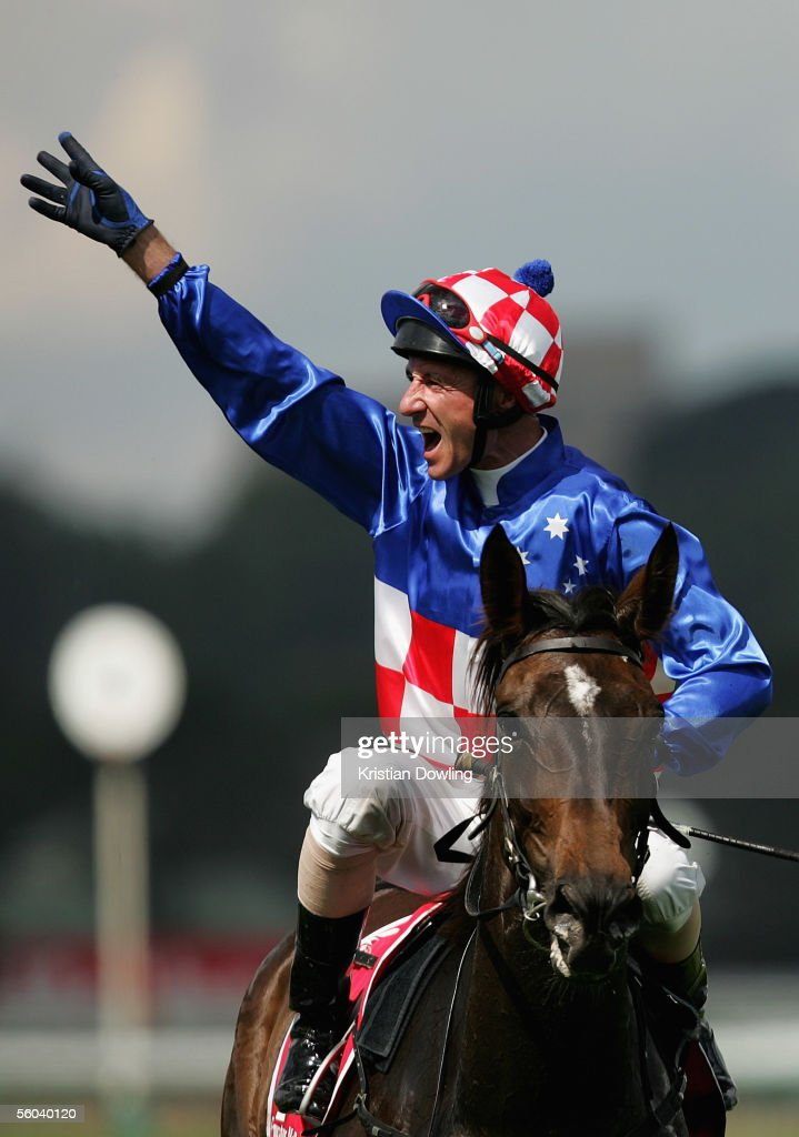 Glen Boss celebrates after riding Makybe Diva to victory in The Melbourne Cup at Flemington Racecourse November 1, 2005 in Melbourne, Australia.