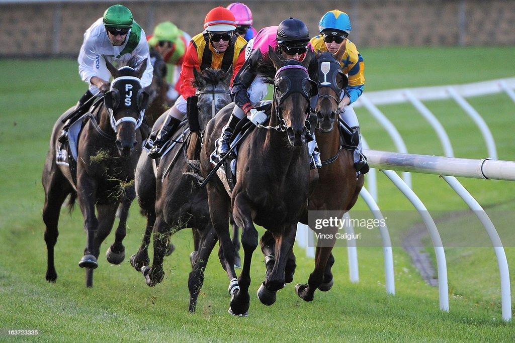Glen Boss riding Baqaat heads around the back of the course in the Chandler Macleod Handicap during Melbourne racing at Moonee Valley Racecourse on March 15, 2013 in Melbourne, Australia.