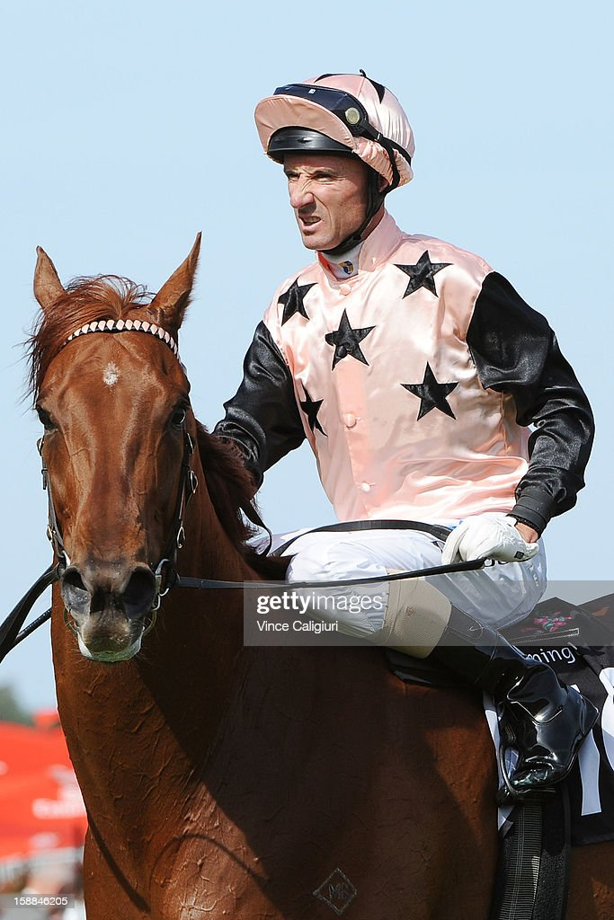<a gi-track='captionPersonalityLinkClicked' href=/galleries/search?phrase=Glen+Boss&family=editorial&specificpeople=194758 ng-click='$event.stopPropagation()'>Glen Boss</a> riding British General reacts after winning the George Watson Handicap during Melbourne Racing at Flemington Racecourse on January 1, 2013 in Melbourne, Australia.