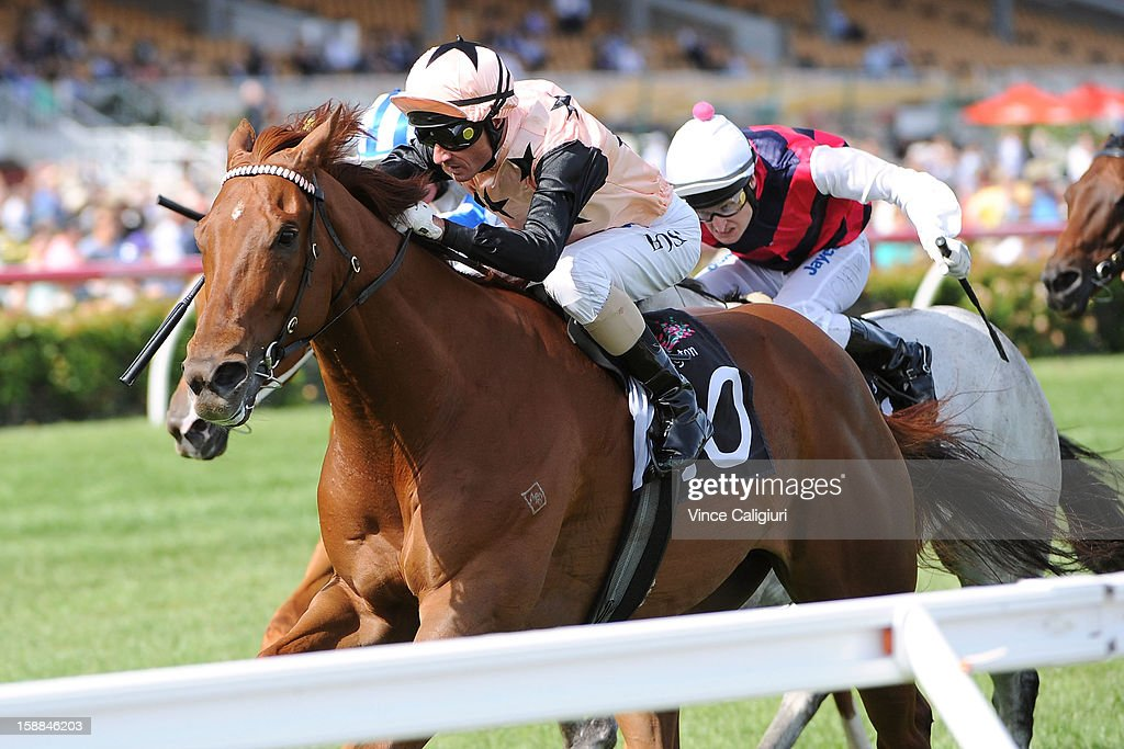Glen Boss riding British General wins the George Watson Handicap during Melbourne Racing at Flemington Racecourse on January 1, 2013 in Melbourne, Australia.
