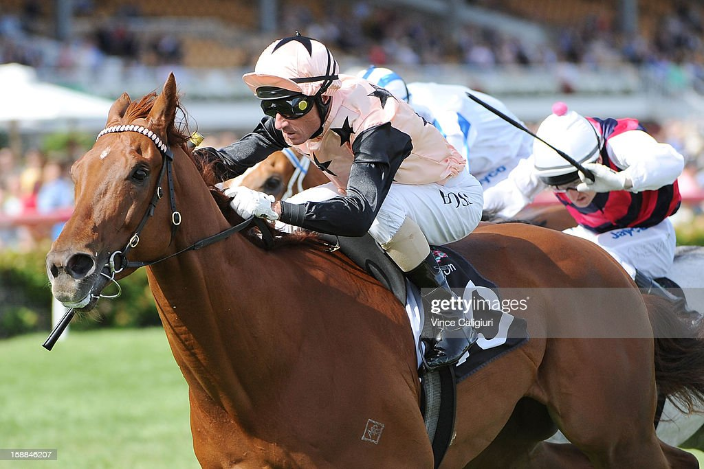 <a gi-track='captionPersonalityLinkClicked' href=/galleries/search?phrase=Glen+Boss&family=editorial&specificpeople=194758 ng-click='$event.stopPropagation()'>Glen Boss</a> riding British General wins the George Watson Handicap during Melbourne Racing at Flemington Racecourse on January 1, 2013 in Melbourne, Australia.