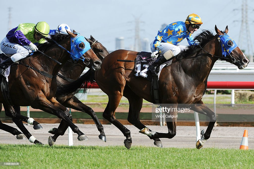 <a gi-track='captionPersonalityLinkClicked' href=/galleries/search?phrase=Glen+Boss&family=editorial&specificpeople=194758 ng-click='$event.stopPropagation()'>Glen Boss</a> riding Crookhaven wins the Williamstown Handicap during Melbourne Racing at Flemington Racecourse on January 1, 2013 in Melbourne, Australia.