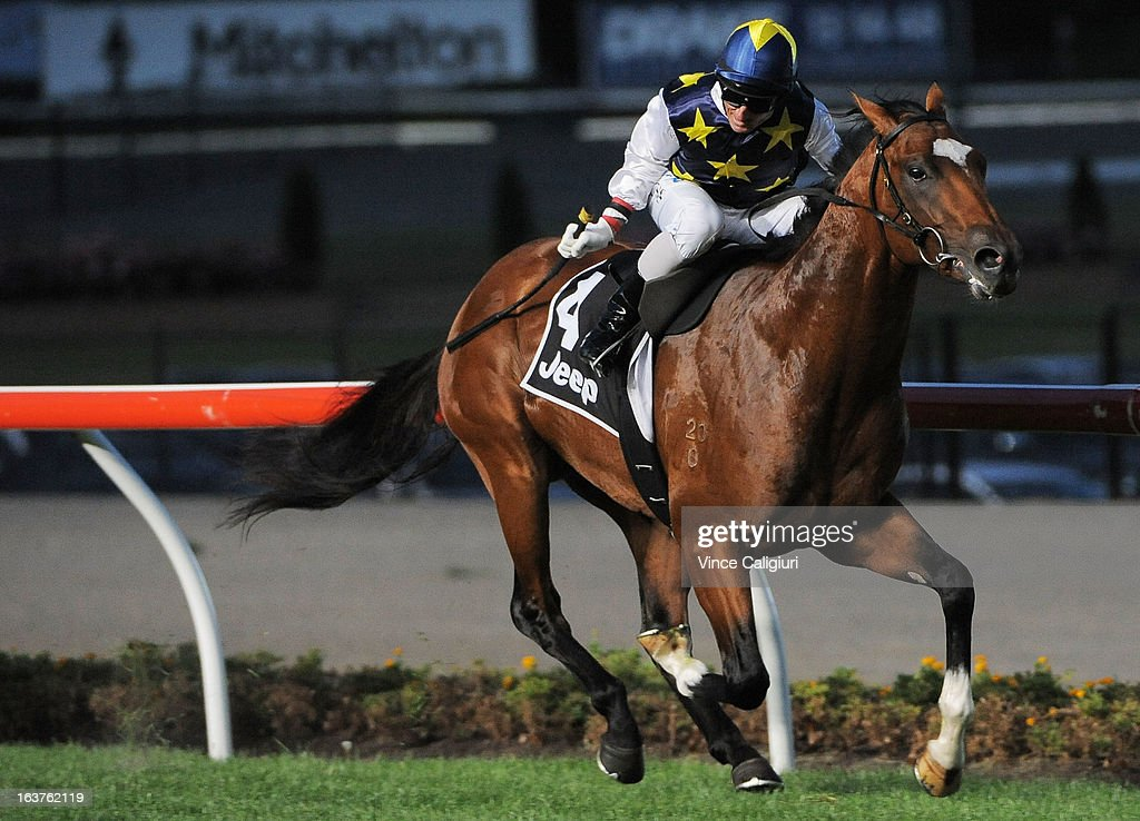 Glen Boss riding Cruden Bay wins the Alternate Railway St Albans Stakes during Melbourne racing at Moonee Valley Racecourse on March 15, 2013 in Melbourne, Australia.
