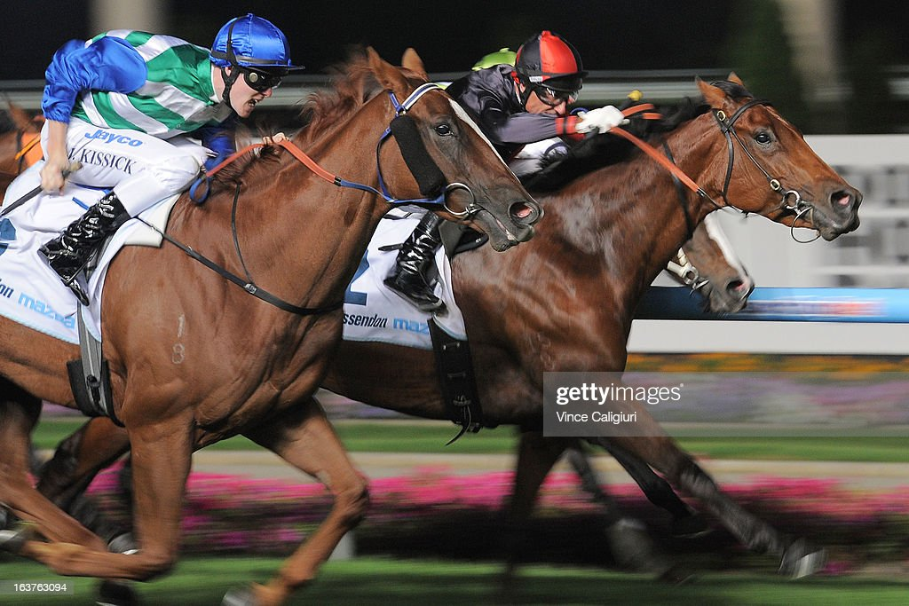Glen Boss riding Lady Melksham defeats John Kissick riding Chinzia in the Essendon Mazda 55 Second Challenge Heat 17 during Melbourne racing at Moonee Valley Racecourse on March 15, 2013 in Melbourne, Australia.